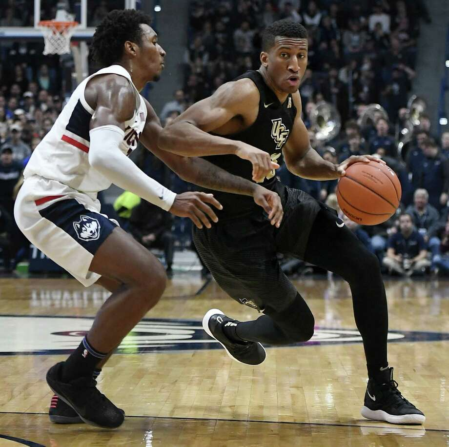Central Florida's Aubrey Dawkins dribbles while defended by UConn's Christian Vital on Jan. 5 in Hartford. Photo: Jessica Hill / Associated Press / Copyright 2019 The Associated Press. All rights reserved