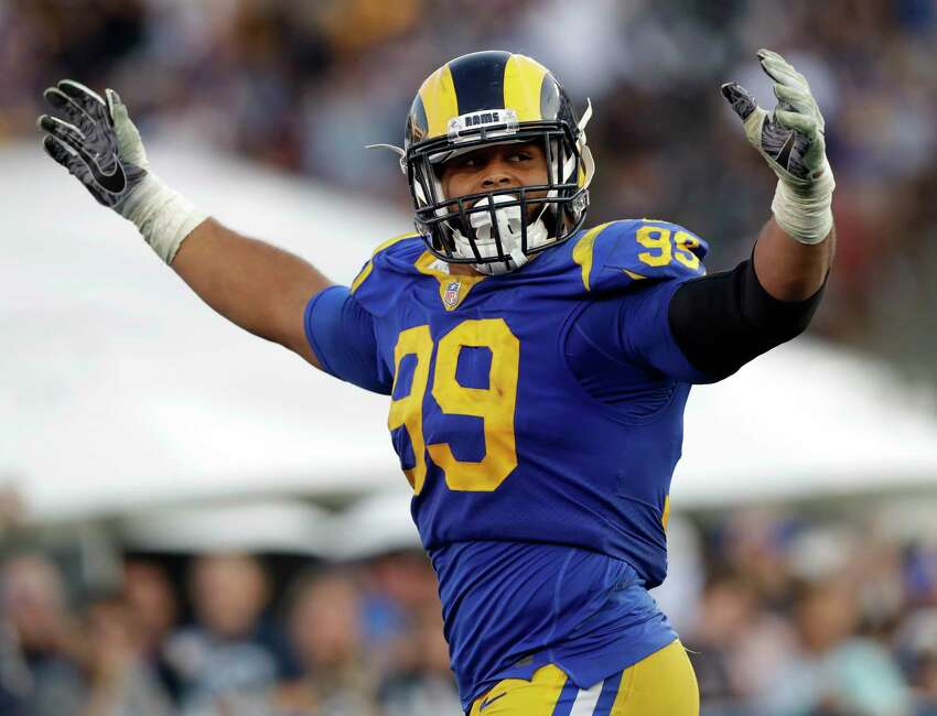FILE - In this Nov. 11, 2018, file photo, Los Angeles Rams defensive end Aaron Donald celebrates a fumble recovery and touchdown by defensive end Dante Fowler during the second half in an NFL football game against the Seattle Seahawks, in Los Angeles. Donald was the only unanimous choice for The Associated Press 2018 NFL All-Pro Team, Friday, Jan. 4, 2018.(AP Photo/Alex Gallardo, File)