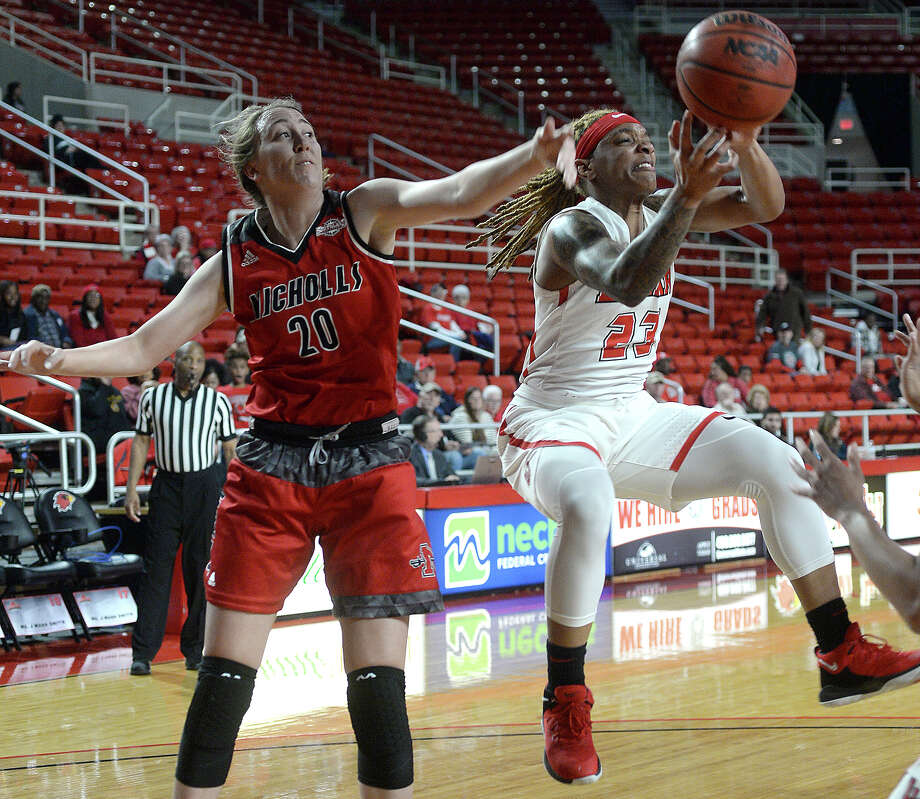 Lamar's Moe Kinard puts up a jumperr against pressure by Nicholls' Cassidy Barrios during their match-up at the Montagne Center Wednesday.  Photo taken Wednesday, January 30, 2019 Photo by Kim Brent/The Enterprise Photo: Kim Brent, The Enterprise / BEN