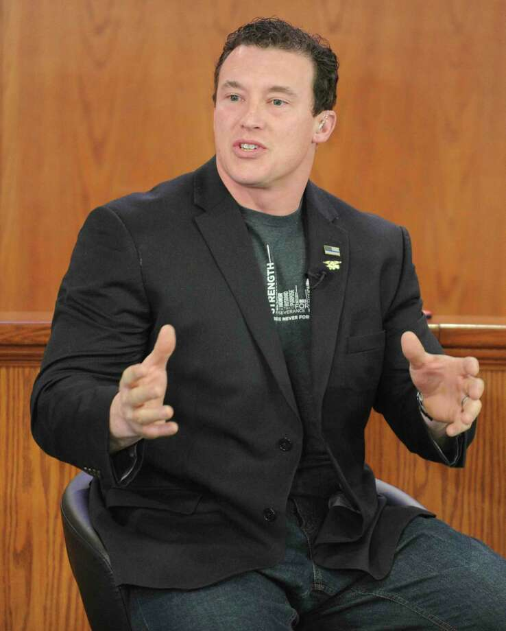 Greenwich resident Carl Higbie hosts a discussion at Greenwich Town Hall on Wednesday. Photo: Matthew Brown / Hearst Connecticut Media / Stamford Advocate