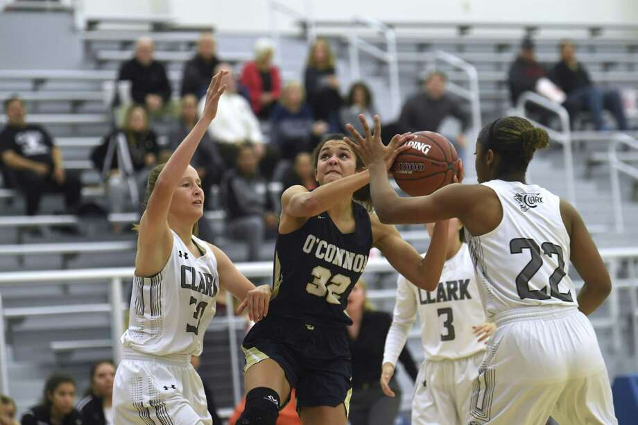 Nicole Hemphill (32) of O'Connor shoots as Cassie Bell (22) and Hailey Adams, left, of Clark defend during girls basketball action at Harlan High School on Wednesday, Jan. 30, 2019. Photo: Billy Calzada, Staff / Staff Photographer / San Antonio Express-News