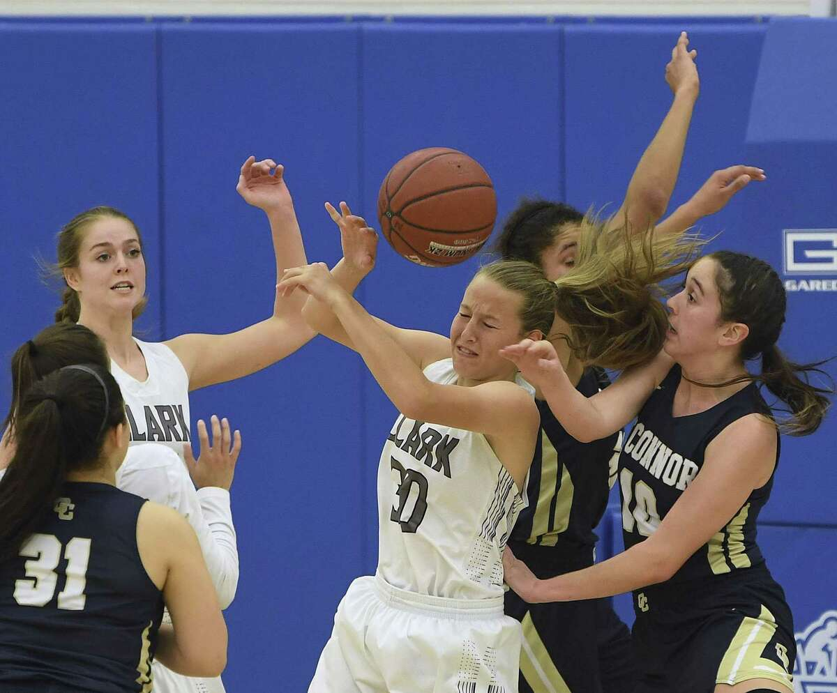 Clark's Hailey Adams (30) battles O'Connor defenders Shannon Bowden (10) and Mili Fowler (31) as teammate Kendall Young, top left, looks on during girls basketball action at Harlan High School on Wednesday, Jan. 30, 2019.