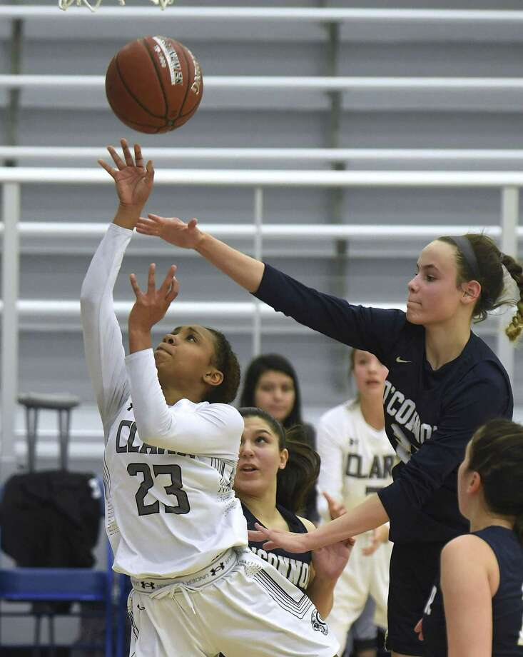 Clark senior giuard Ta'Niya Jackson, left, scored 27 points, grabbed 10 rebounds and dished six assists in a 6A playoff victory against Smithson Valley. Photo: Billy Calzada /Staff Photographer / San Antonio Express-News