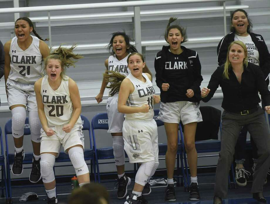 Clark basketball coach Rihana Houy, right, and her bench cheer as time winds down on their come-from-behind 42-40 victory over O'Connor in a key 28-6A battle on Wednesday. Photo: Billy Calzada / Staff Photographer / San Antonio Express-News