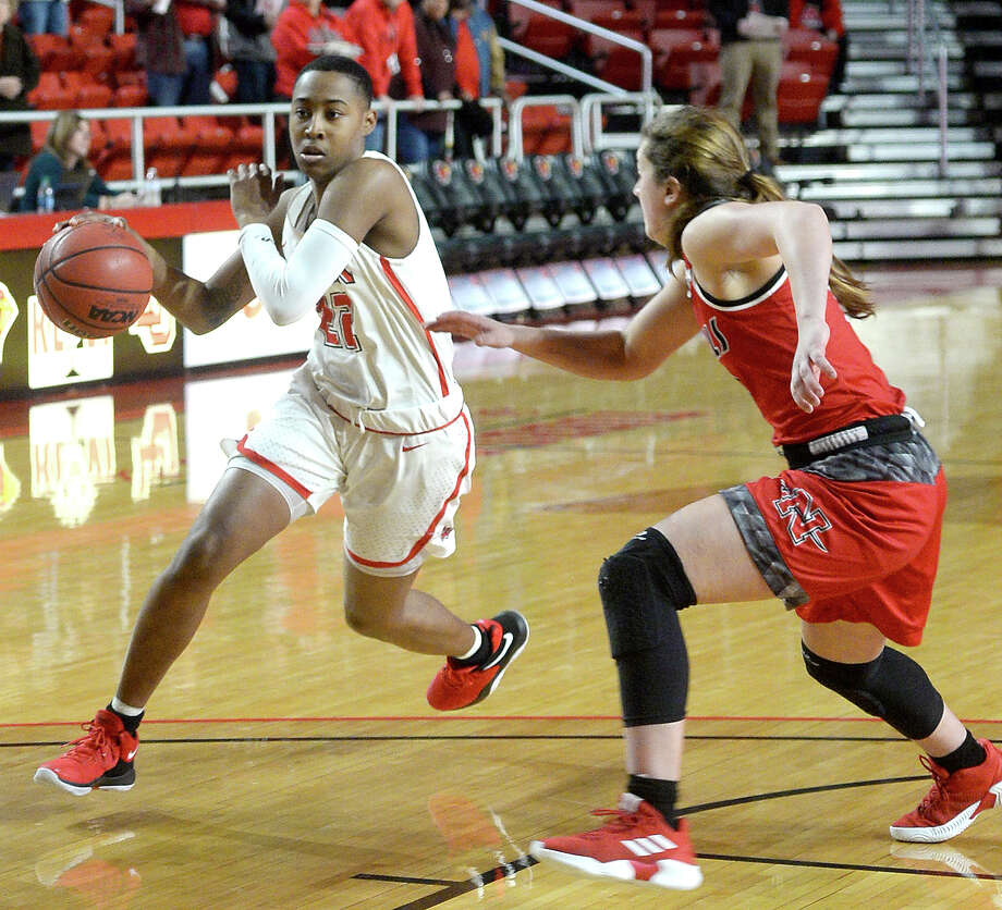 Lamar's Miya Crump drives down court against Nicholls during their match-up at the Montagne Center Wednesday.  Photo taken Wednesday, January 30, 2019 Photo by Kim Brent/The Enterprise Photo: Kim Brent/The Enterprise