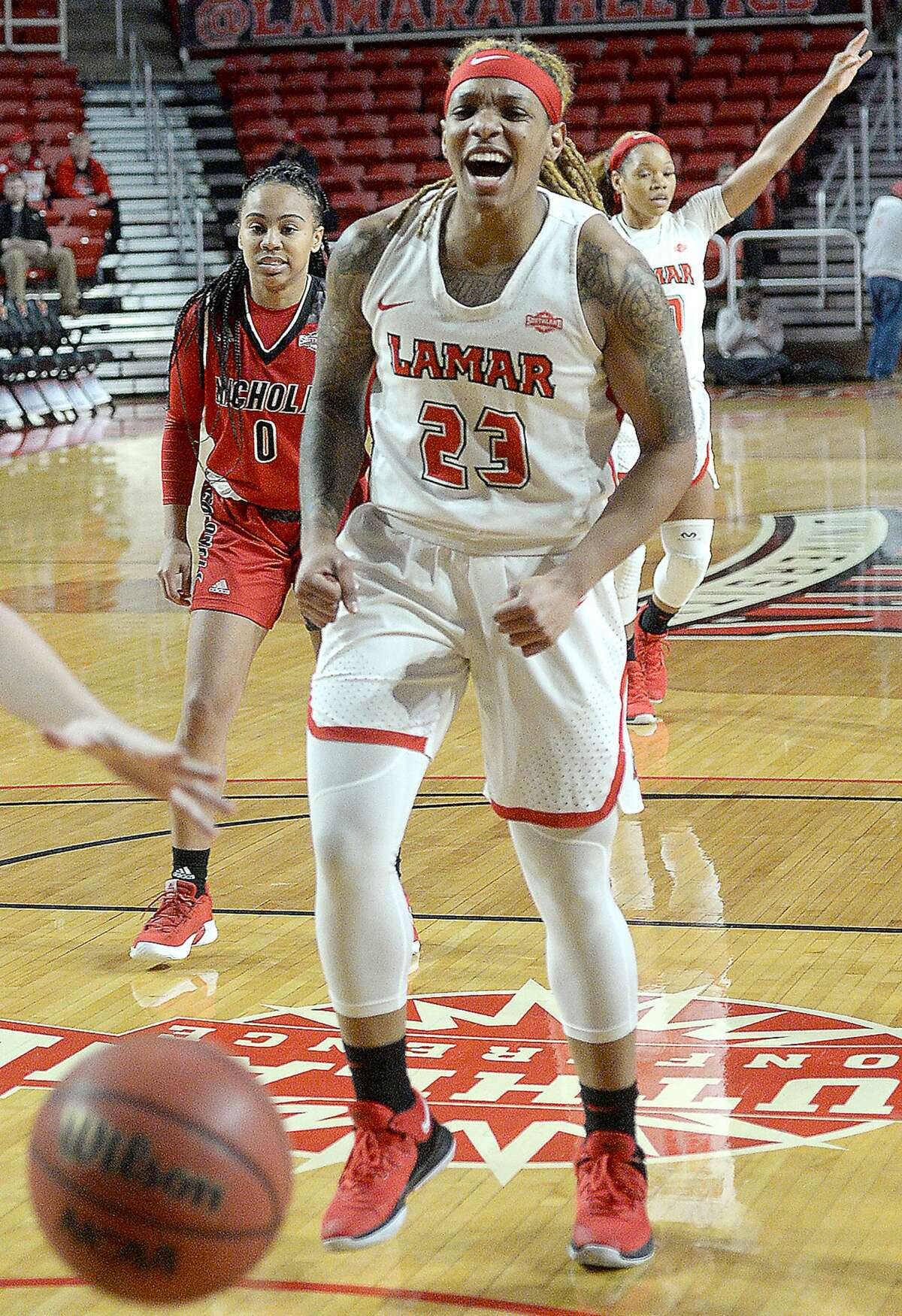 Lamar's Moe Kinard reacts after teammate Ashlan Miles sinks a three-pointer against Nicholls during their match-up at the Montagne Center Wednesday. Photo taken Wednesday, January 30, 2019 Photo by Kim Brent/The Enterprise