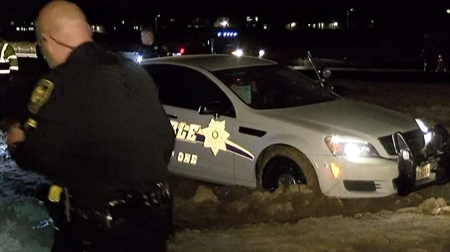 A chase involving Harris County Precinct 1 deputy constables and a suspected drunken driver ended with the suspects and a number of squad cars stuck in the mud Wednesday night in the Humble area. Photo: Scott Engle / Montgomery County Police Reporter