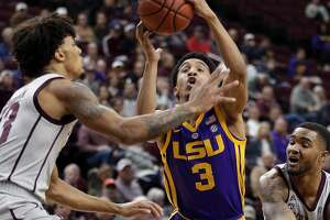LSU guard Tremont Waters (3) drives to the basket between Texas A&M guard Brandon Mahan, left, and guard TJ Starks, right, during the first half of an NCAA college basketball game Wednesday, Jan. 30, 2019, in College Station, Texas. (AP Photo/Michael Wyke)