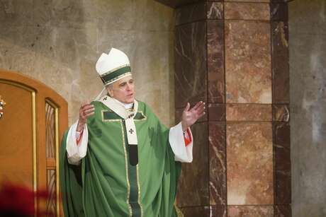 Cardinal Daniel DiNardo shares words with the congregation at the Co-Cathedral of the Sacred Heart in Houston.