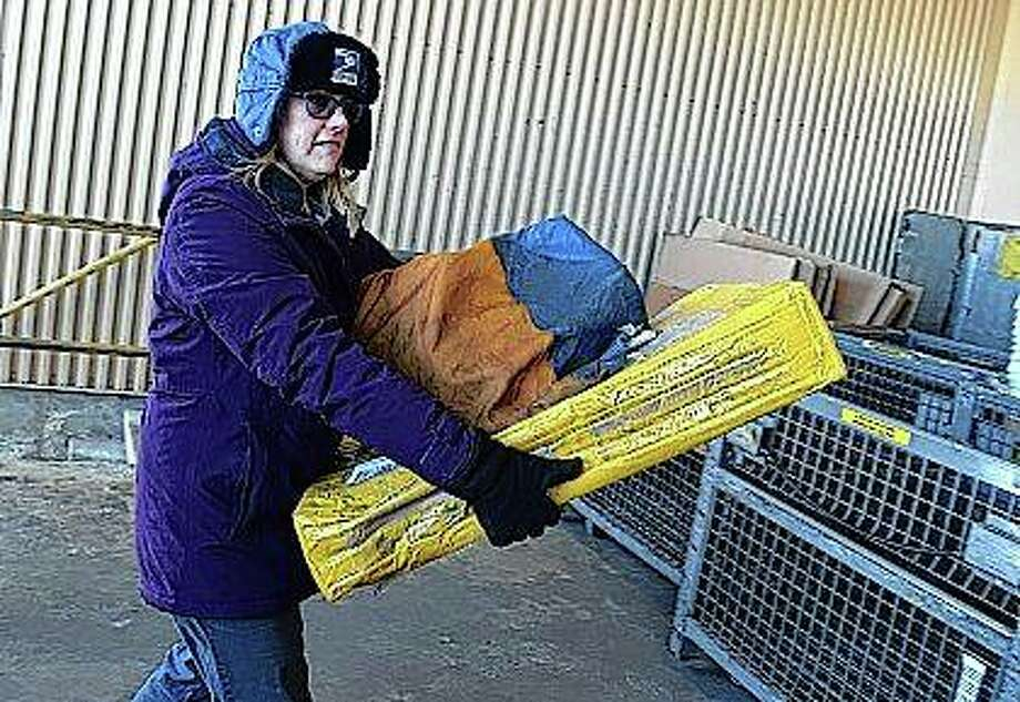 Lead Clerk Brooke Smith unloads mail Wednesday at the Jacksonville post office. Photo: Rosalind Essig | Journal-Courier