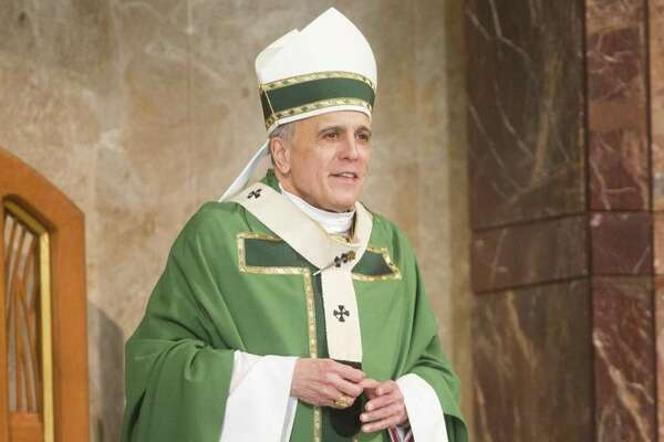 Cardinal Daniel DiNardo shares words with the congregation at the Co-Cathedral of the Sacred Heart, Sunday, Jan. 20, 2019, in Houston.