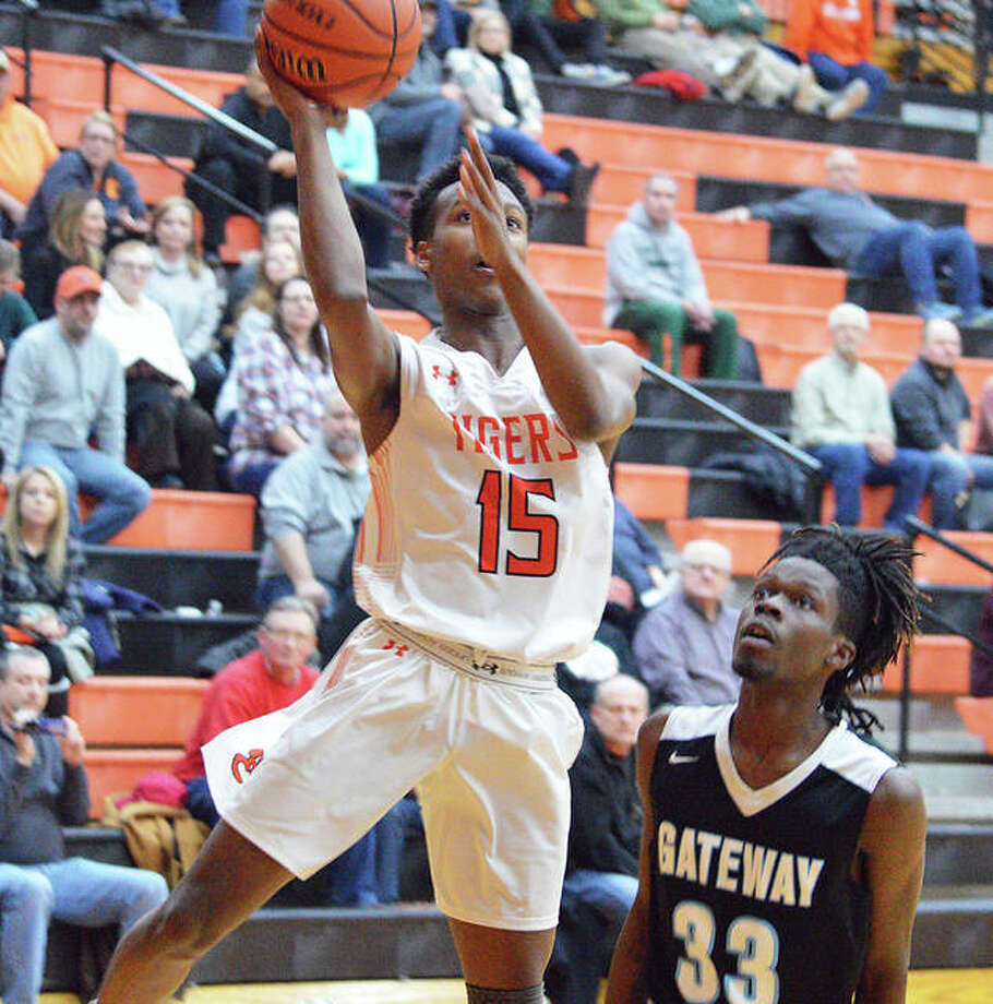 Edwardsville senior Jaylon Tuggle, left, goes up for a shot during Tuesday's game against Gateway STEM at Lucco-Jackson Gymnasium. Photo: Scott Marion/Intelligencer