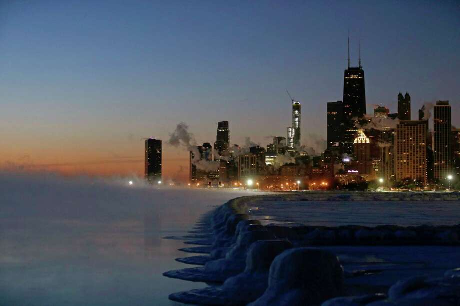 Ice forms along the shore of Lake Michigan before sunrise, Thursday, Jan. 31, 2019, in Chicago. The painfully cold weather system that put much of the Midwest into a historic deep freeze was expected to ease Thursday, though temperatures still tumbled to record lows in some places. Photo: Kiichiro Sato, AP / Copyright 2019 The Associated Press. All rights reserved.