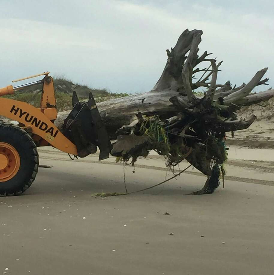Beach debris being cleared along South Beach near mile marker 17. Photo: Nick Meyers