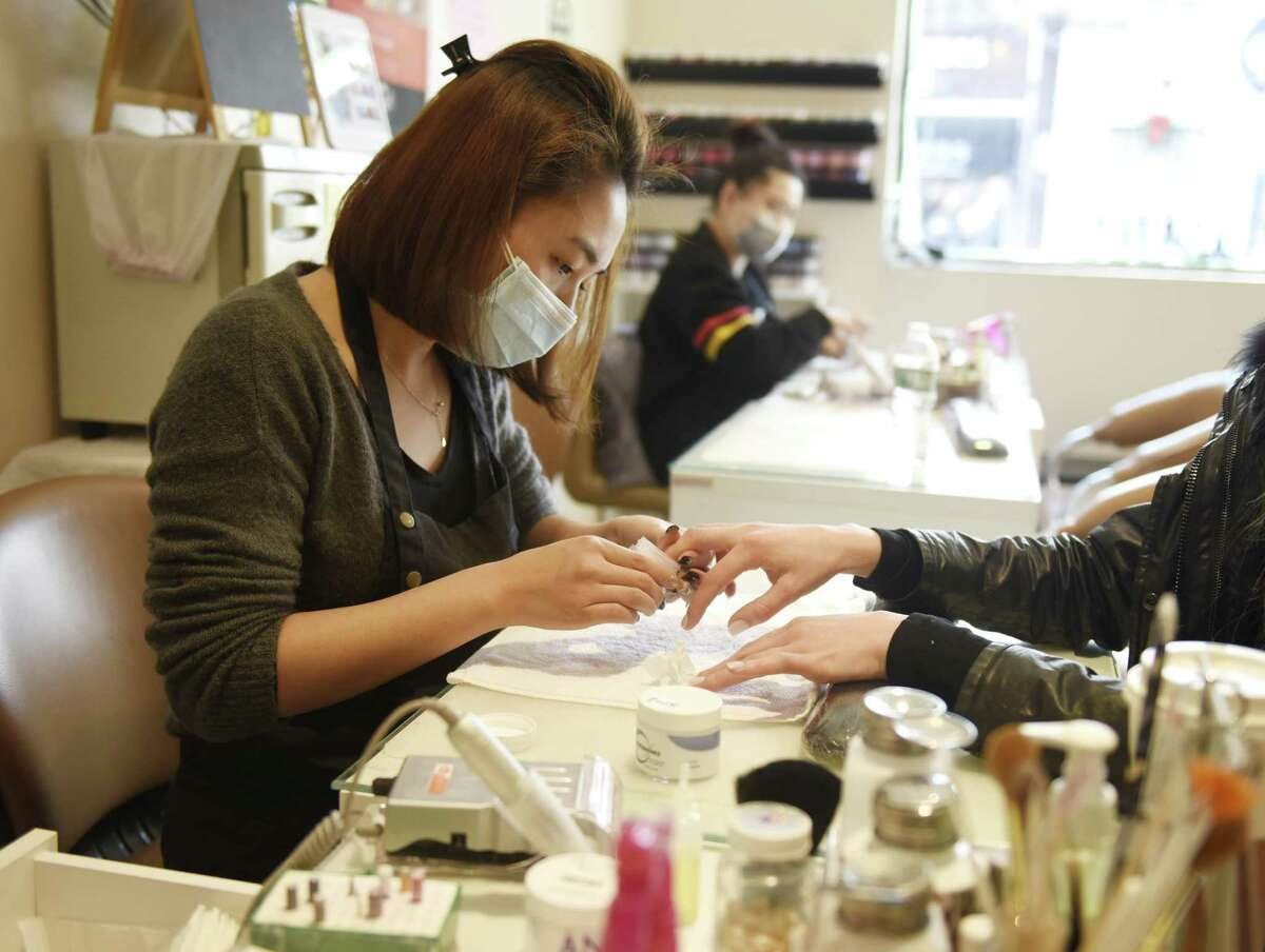 Employees work at In Nails and Spa in Stamford, Conn. on Wednesday, Jan. 16, 2019.