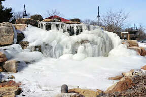 """The mound of ice spotted near Mike Shannon's restaurant in Edwardsville was apparently the result of a """"polar vortex"""" that swept into the region Tuesday night into Wednesday. With the temperature outside at several degrees below zero, and the wind chill factor much colder, water flowing was frozen solid around rocks and soil at The Park at Plum Creek area Wednesday afternoon."""