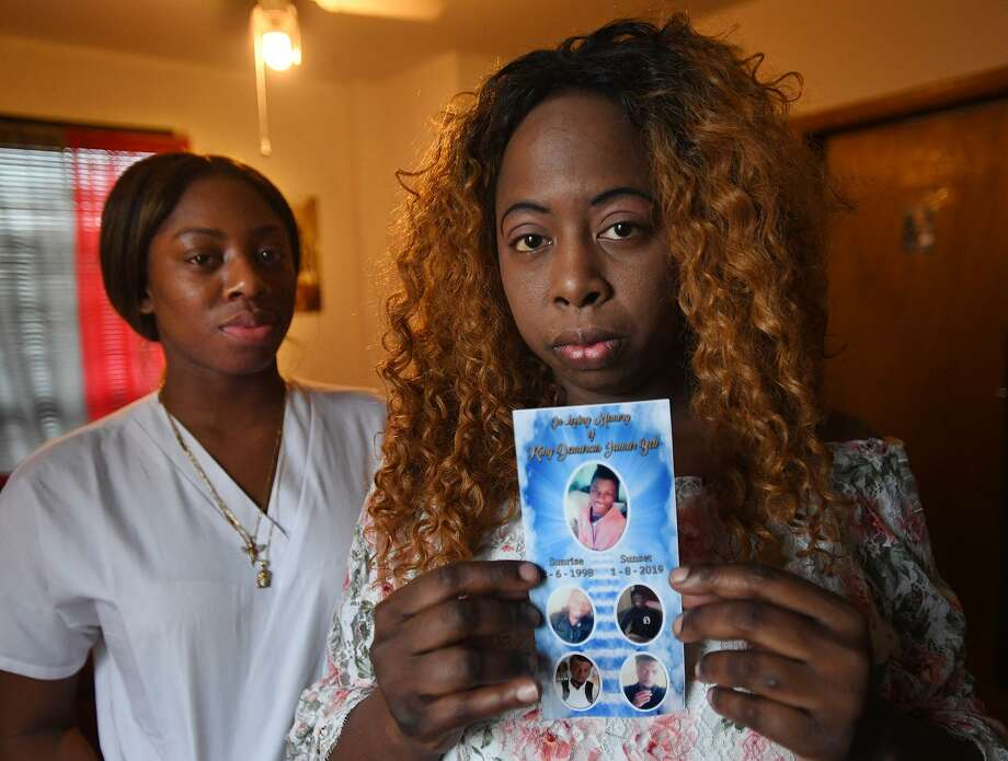 Standing beside her daughter Dehonna Bell, left, Edith Bell holds the funeral service photo of her son, Demarius Bell, who hung himself at their Stratford home on January 8. After discovering her son's body, Bell made repeated calls to 911 that went unanswered. Photo: Brian A. Pounds / Hearst Connecticut Media / Connecticut Post