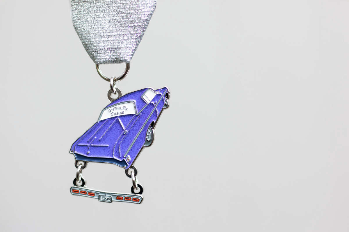 Rather than hanging a compromised car part in a garage, party-goers can honor the beloved scene by hanging Infante's medal from their sashes. And while the