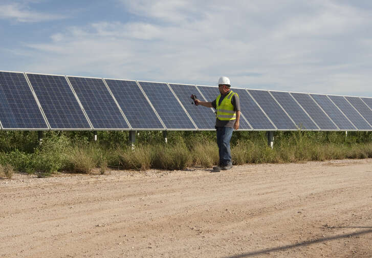 White male uses thermal imaging camera to perform quality control and check for bad cells at the Webberville Solar Farm, the largest active solar project of any public power utility in the country. It has over 127,000 modules and can generate more than 61 million kWh of electricity, (Photo by Robert Daemmrich Photography Inc/Corbis via Getty Images)