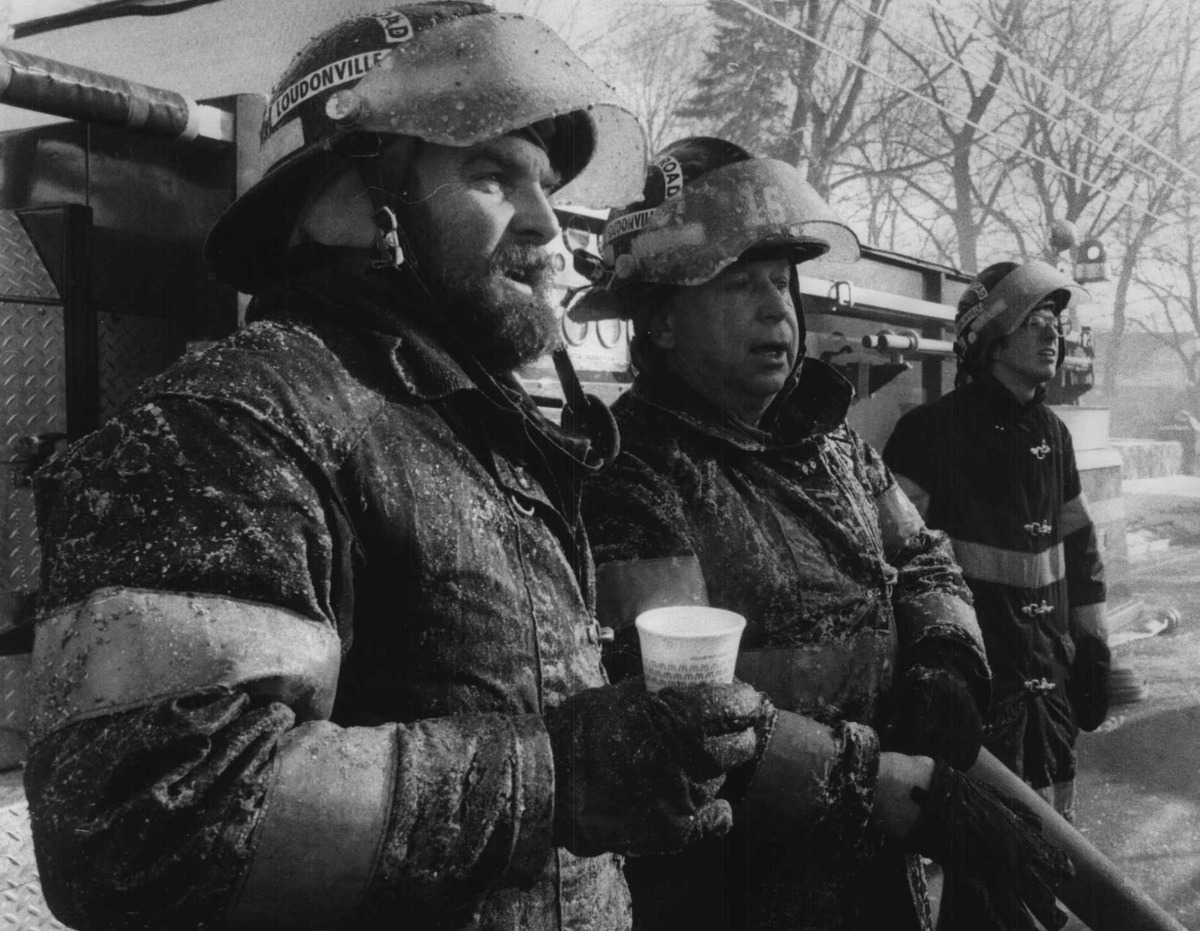 Old Loudon Road, Latham, New York - ice-covered firefighters take a break while fighting the fire that destroyed the upper floor of a building in Latham. January 09, 1985 (Paul D. Kniskern/Times Union Archive)