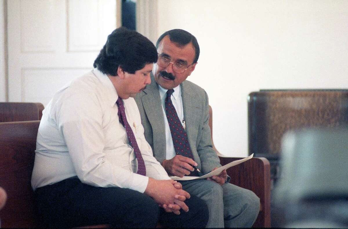Former Catholic priest Fernando Noe Guzman speaks with his attorney, Candelario Elizondo, in 1992 at the Grimes County courthouse in Anderson, north of Houston. Guzman was accused of molesting a 14-year-old girl at her grandfather's home. The allegations against him surfaced after a church secretary in Galena Park file a multimillion-dollar lawsuit accusing him of forcing her into a sexual relationship. The lawsuit was dismissed, but Guzman was charged with sexual assault in Grimes County. He pleaded guilty, was granted shock probation and served 90 days in jail. Guzman, who died in 2006, was removed from the ministry in 1987.