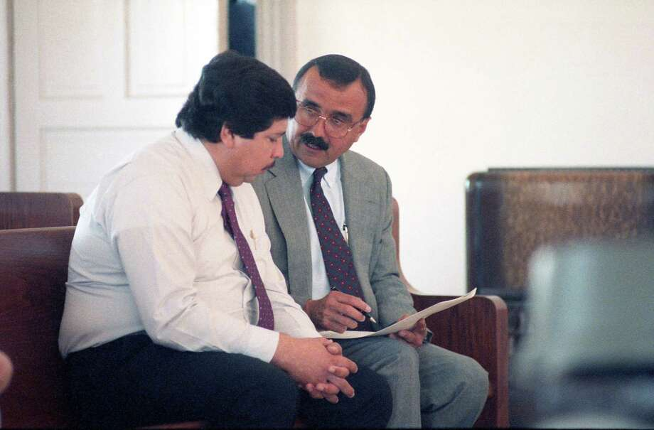 Former Catholic priest Fernando Noe Guzman speaks with his attorney, Candelario Elizondo, in 1992 at the Grimes County courthouse in Anderson, north of Houston.  Guzman was accused of molesting a 14-year-old girl at her grandfather's home. The allegations against him surfaced after a church secretary in Galena Park file a multimillion-dollar lawsuit accusing him of forcing her into a sexual relationship. The lawsuit was dismissed, but Guzman was charged with sexual assault in Grimes County. He pleaded guilty, was granted shock probation and served 90 days in jail. Guzman, who died in 2006, was removed from the ministry in 1987. Photo: King Chou Wong,  HP Staff / Houston Chronicle / © Houston Chronicle