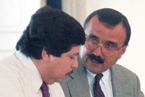 Former Catholic priest Fernando Noe Guzman speaks with his attorney, Candelario Elizondo, in 1992 at the Grimes County courthouse in Anderson, north of Houston.