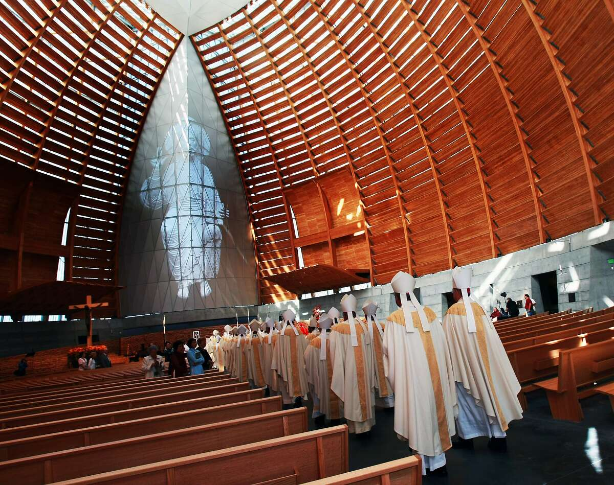 FILE -- Visiting Bishops walk down the center aisle during the dedication ceremony of The Cathedral of Christ the Light Thursday in Oakland, Calif. An Oakland priest has apparently fled the country after being placed on leave and accused of sexual misconduct with a minor.