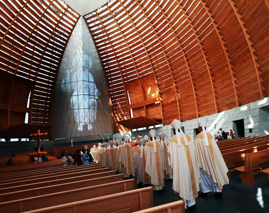 FILE -- Visiting Bishops walk down the center aisle during the dedication ceremony of The Cathedral of Christ the Light Thursday in Oakland, Calif. An Oakland priest has apparently fled the country after being placed on leave and accused of sexual misconduct with a minor. Photo: Lance Iversen / The Chronicle