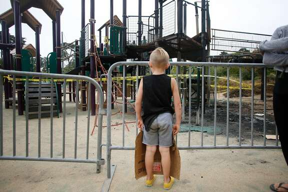 Achilles Horner, 5, of San Luis Obispo, takes in the view of the  vandalized play structure at Koret Children's playground in Golden Gate Park during a visit with his family on Wednesday, June 28, 2017 in San Francisco, Calif.