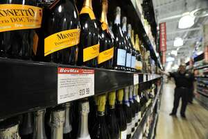Bottles of Mionetto prosecco on display at the BevMax liquor store in Stamford.