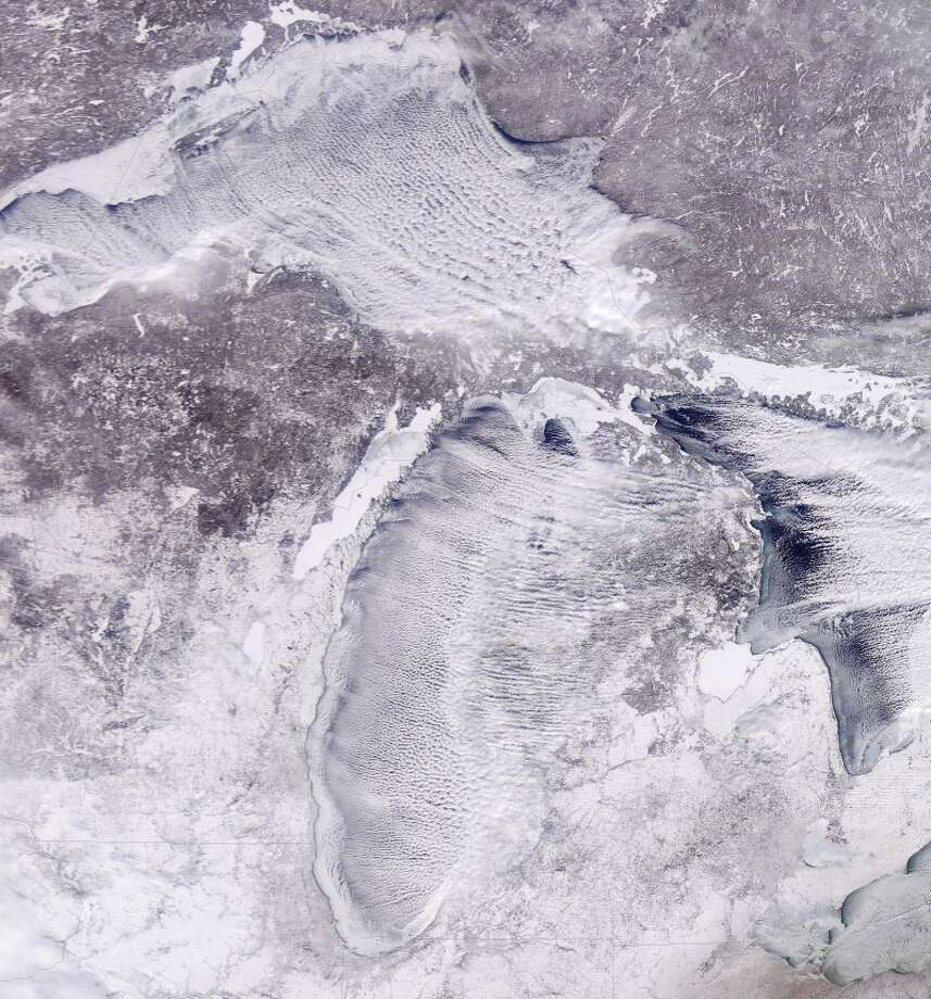 It sure looks like winter in Lower Michigan from space Thursday afternoon from the latest satellite imagery from the MODIS sensors. Check out the continued lake effect clouds streaming off the Great Lakes, and ice build-up on Lake Michigan!