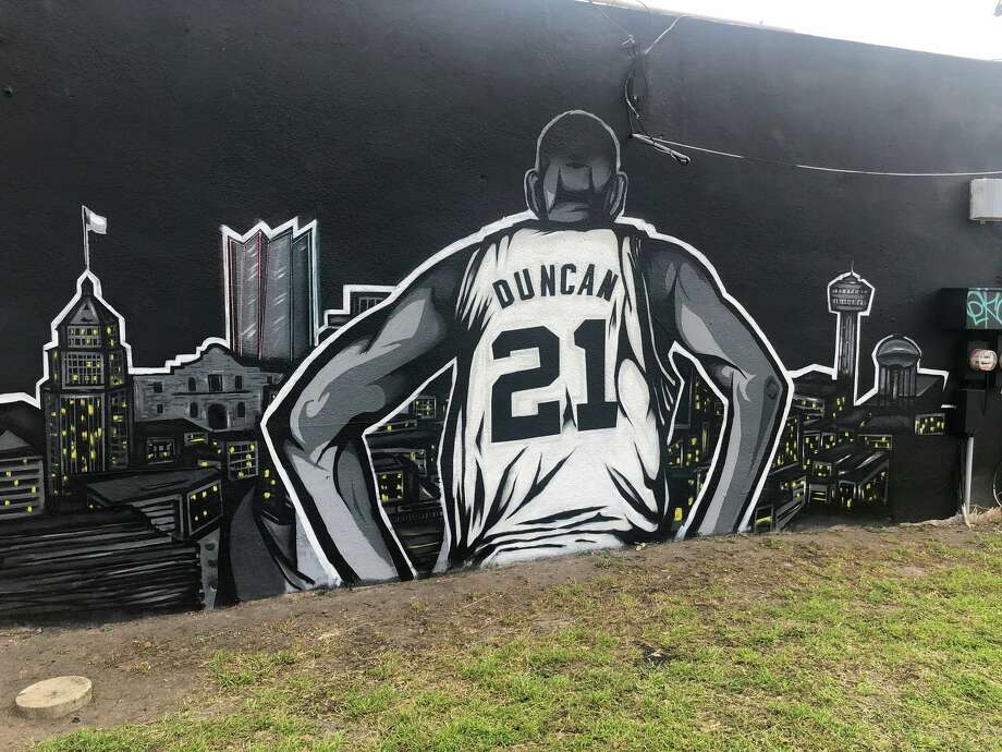 An exterior wall of Countdown City Cuts, a 6730 S. Flores St. barber shop, once featured a portrait of Leonard. His face was then emblazoned with a red ban following his exit and now, it's been transformed into a tribute to the most-respected Spur in franchise history, Tim Duncan. Photo: Courtesy, Steve Castilleja