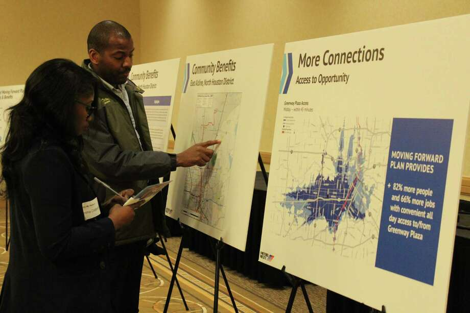 Metro employees look at the community benefits for the North Houston, Aldine area. Photo: Kaila Contreras