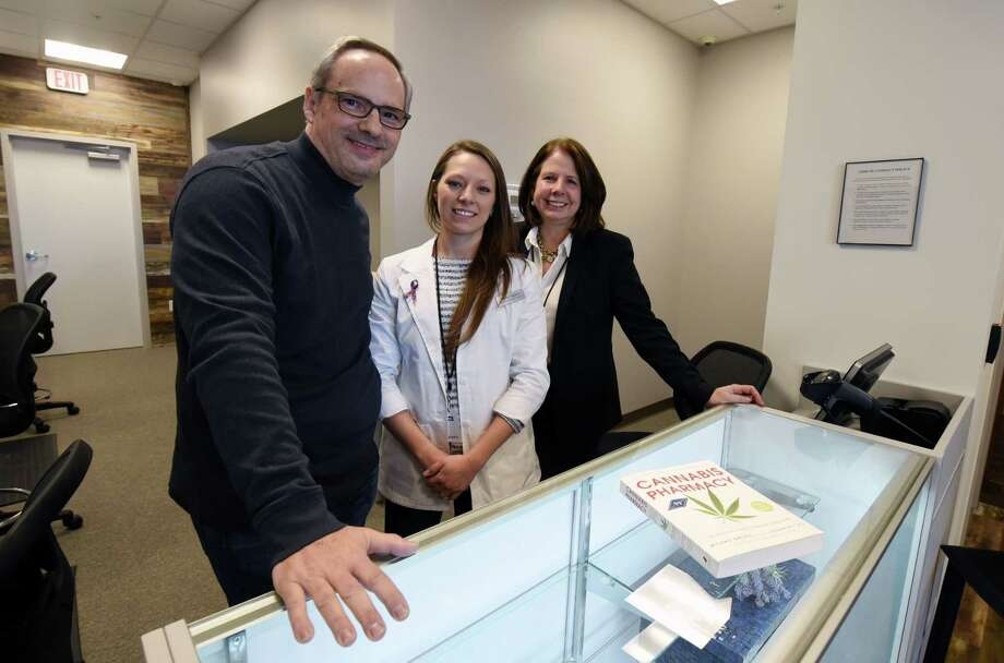 From left, Fiorello Pharmaceuticals co CEO Eric Sirota, dispensary manager Katie Ogden and co CEO Susan Yoss smile for a portrait at the new Fiorello Pharmaceuticals dispensary Thursday, Jan. 31, 2019 in Halfmoon, NY. (Phoebe Sheehan/Times Union) Photo: Phoebe Sheehan, Albany Times Union / 40046078A