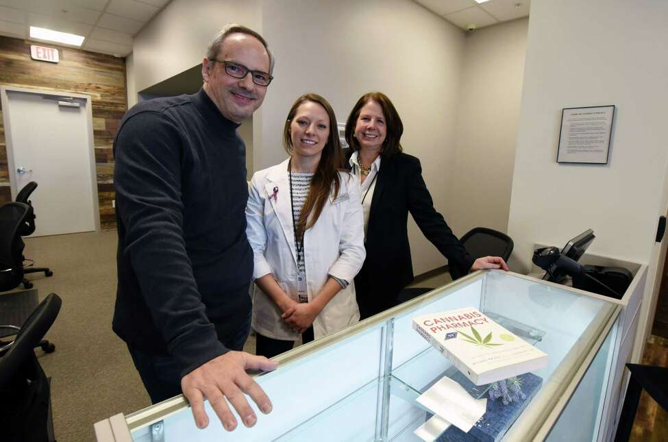 From left, Fiorello Pharmaceuticals co CEO Eric Sirota, dispensary manager Katie Ogden and co CEO Susan Yoss smile for a portrait at the new Fiorello Pharmaceuticals dispensary Thursday, Jan. 31, 2019 in Halfmoon, NY. (Phoebe Sheehan/Times Union)