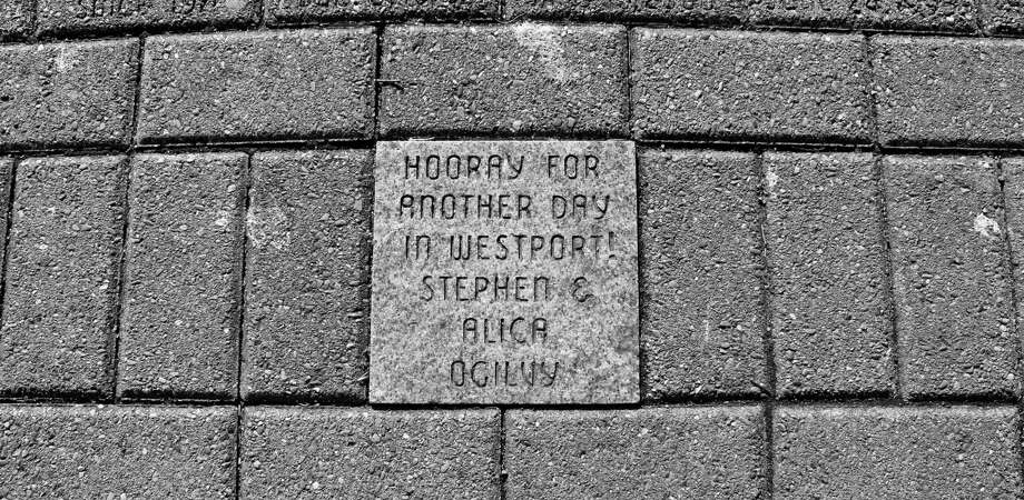 "A brick along path next to the Westport Library says ""Hooray For Another Day in Westport"" along with the names of Stephen and Alicia Ogilvy. Photo: Sophie Vaughan / Hearst Connecticut Media / Westport News"