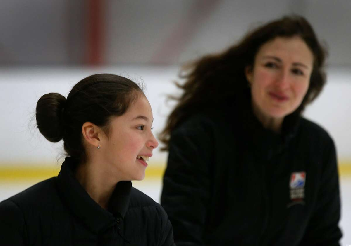 Newly crowned U.S. Women's Figure Skating champion Alysa Liu trains with her coach Laura Lipetsky (right) at the Oakland Ice Center in Oakland, Calif. on Thursday, Jan. 31, 2019.