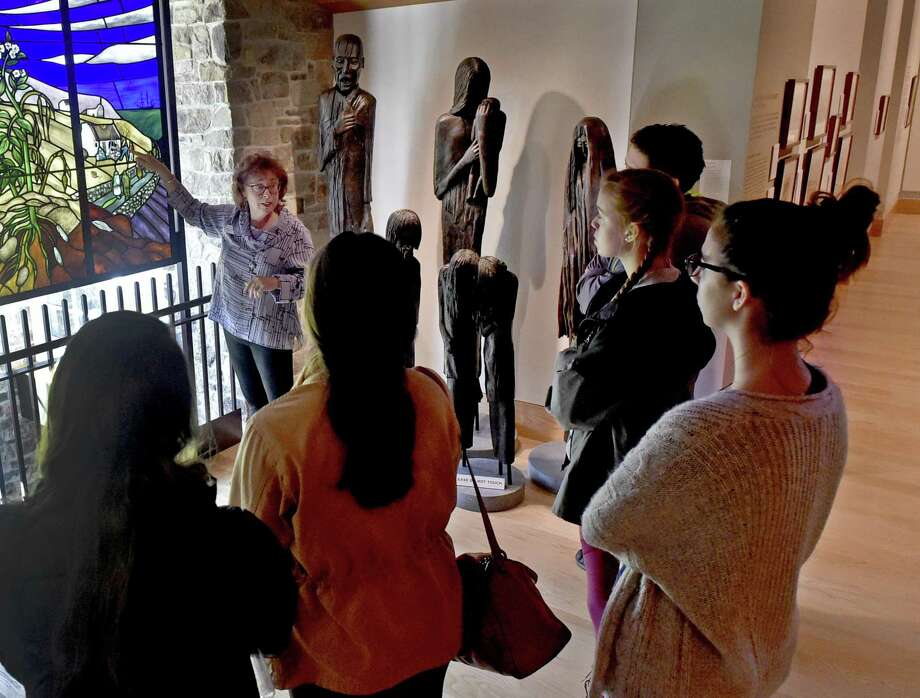 Hamden, Connecticut - Saturday, November 3, 2018: Mary Cortright (CQ), a docent at the Quinnipiac University Ireland's Great Hunger Museum in Hamden, gives a tour to the museum during an outing Saturday afternoon for the Quinnipiac University Honors Program students. Photo: Peter Hvizdak / Hearst Connecticut Media / New Haven Register