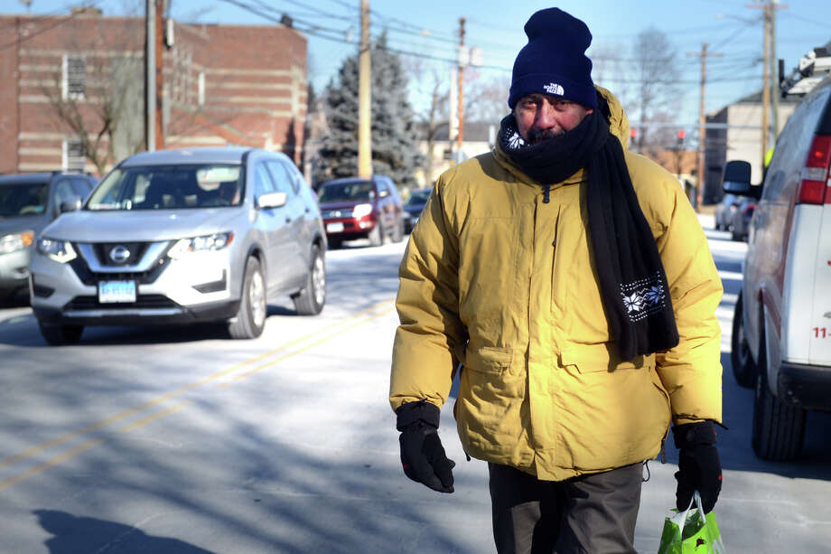Afiran Espinet, of Bridgeport, braves the frigid cold temperatures as he walks home along Mill Hill Ave. after shopping for groceries in Bridgeport, Conn. Jan. 31, 2019. Photo: Ned Gerard, Hearst Connecticut Media / Connecticut Post