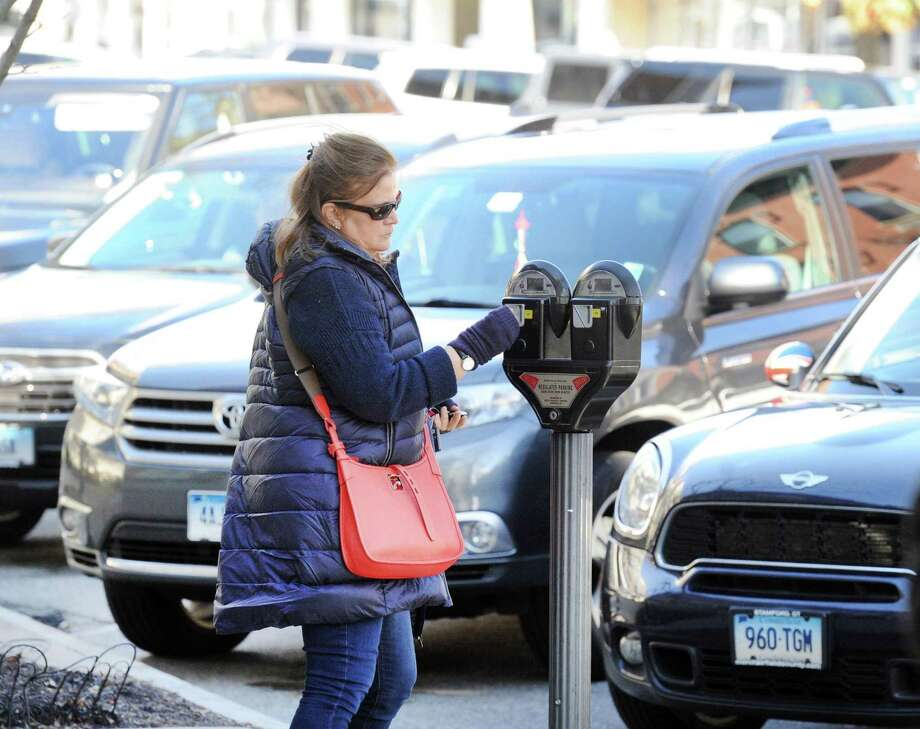 No loose change? No worries. The Parkmobile app has been expanded for use at meters on Greenwich Avenue. Photo: File / Hearst Connecticut Media / Greenwich Time