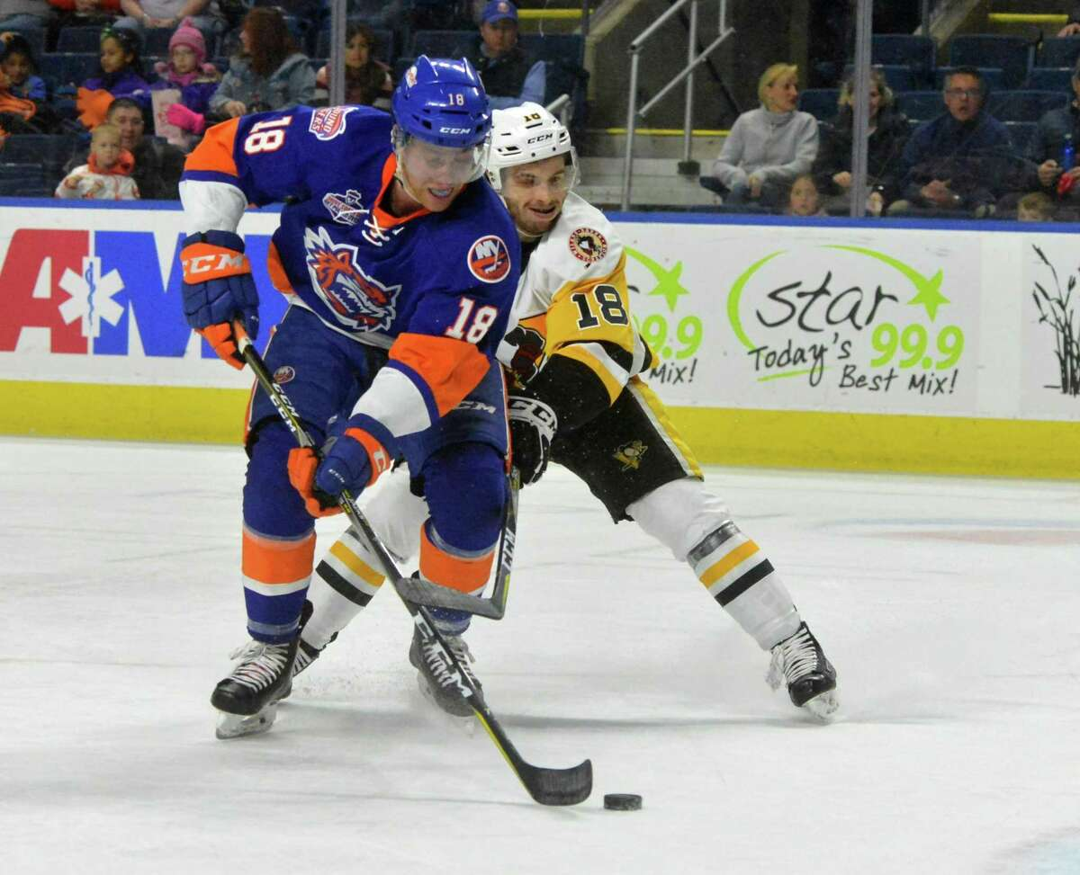 The Bridgeport Sound Tigers #18 John Stevens grabs the puck from Wilkes Barre/Scranton's #18 Gage Quiney during hockey action at Webster Bank Arena in Bridgeport Conn. on Sunday April 8, 2018