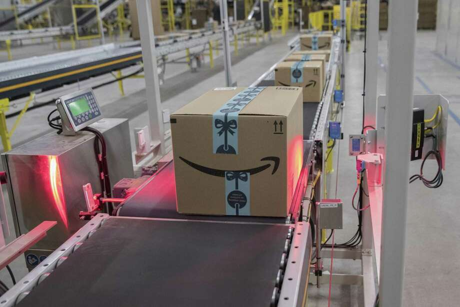 In this Dec. 5, 2018, photo a box is scanned and weighed before at the Amazon fulfillment center on Staten Island borough of New York. Amazon reports financial results Thursday, Jan. 31, 2019. (AP Photo/Mary Altaffer) Photo: Mary Altaffer / Associated Press / Copyright 2019 The Associated Press. All rights reserved.