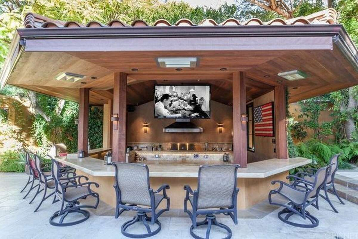 The tricked-out bachelor pad of infamous celebrity Charlie Sheen has seen a drastic price reduction.