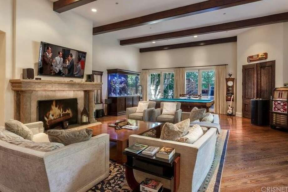 The tricked-out bachelor pad of infamous celebrity Charlie Sheen has seen a drastic price reduction. Photo: Realtor.com
