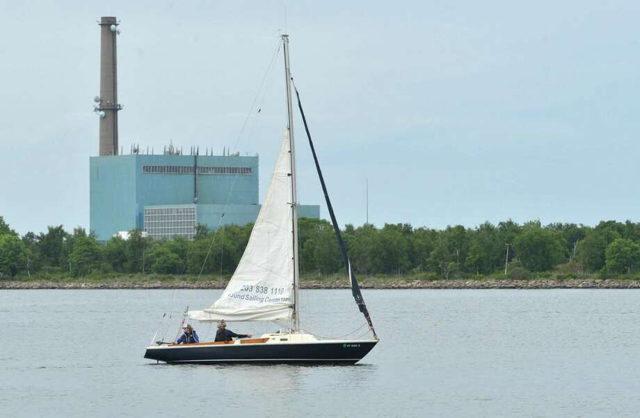 A sailboat heads into Norwalk Harbor with Manresa Island and the decommissioned power plant in the background in June 2018 in Norwalk Conn. Photo: Alex Von Kleydorff / Hearst Connecticut Media / Norwalk Hour
