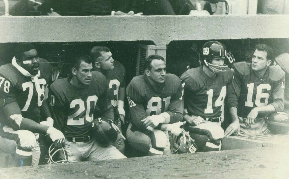 New York Giants Andy Robustelli (No. 81), Y.A. Tittle (No. 14), and Frank Gifford (No. 16).