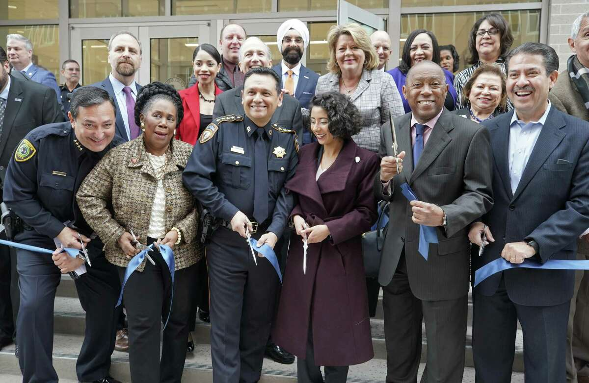 Houston Police Chief Art Acevedo, left, U.S. Rep. Sheila Jackson Lee, Harris County Sheriff Ed Gonzalez, Harris County Judge Lina Hidalgo, Houston Mayor Sylvester Turner, and Harris County Pct. 2 Commissioner Adrian Garcia, right, participate in a ribbon cutting ceremony outside the Joint Processing Center, 700 N. San Jacinto, Thursday, Jan. 31, 2019, in Houston. The center consolidates all Houston Police Department and Harris County Jail inmate processing functions into a single facility.