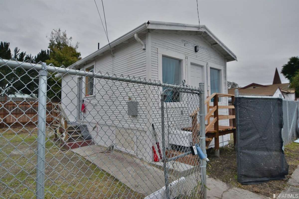 Tiny fixer-upper house on a sunny lot in East Oakland listed for $235,000.
