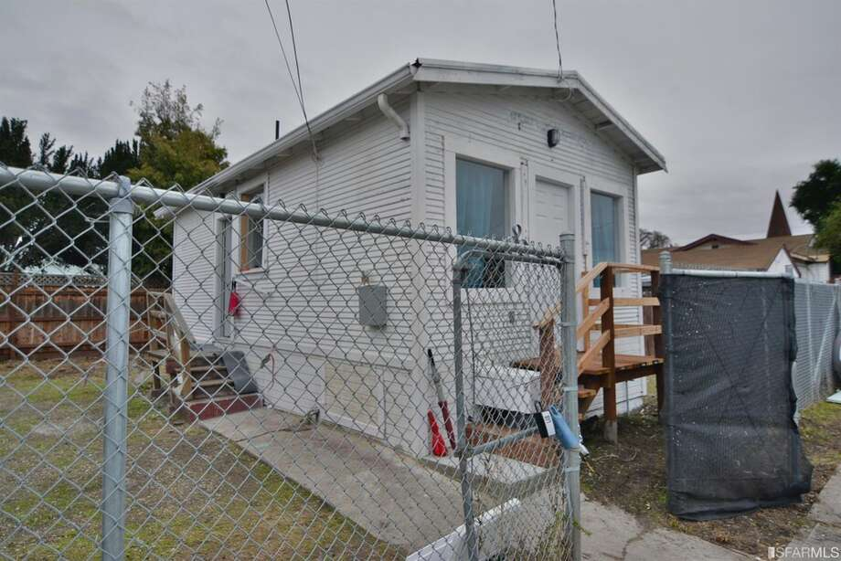 Tiny fixer-upper house on a sunny lot in East Oakland listed for $235,000. Photo: Robert Collett Of Berkshire Hathaway